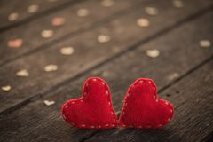 Wedding and Valentines day concept. Two red heart with a lot of wooden hearts on wooden background with vintage style. Broken hearted, Love forever, Wedding and Royalty Free Stock Photography