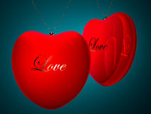 Two red heart pendents with gold inscription love Royalty Free Stock Photography