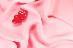 Two red heart on pink Stock Photography