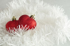 Two red heart shape baubles Royalty Free Stock Photography