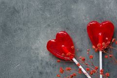 Free Two Red Heart Shape Candy Lollipops On Sticks Flowers On Dark Stone Background. Valentine Romantic Love Greeting Card Stock Image - 108285071