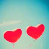 Two red Heart-shaped balloons Royalty Free Stock Photos