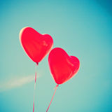Two red Heart-shaped balloons Royalty Free Stock Photography