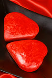 Two red heart shaped cakes Stock Image