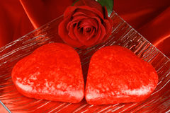 Two red heart shaped cakes and a rose Stock Photography