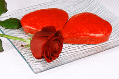 Two red heart shaped cakes and a rose Royalty Free Stock Photography
