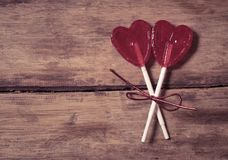 Two red heart shaped lollipops as metaphor of love, togetherness and Valentines day concept stock image