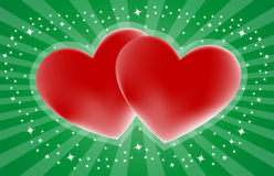 Two red heart shapes on green Stock Images