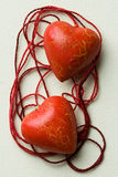 Two red heart shapes in thread cobweb Stock Photos