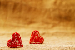 Two red heart on a turquoise background St. Valentine`s Day Royalty Free Stock Photography