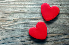 Two red heart on a wooden old background. Romantic card. Royalty Free Stock Photo