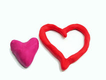 Two red hearths made from plasticine Stock Photo