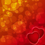 Two red hearts. On bokeh background Stock Photography