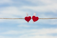 Two red hearts on a background of the sky Stock Image