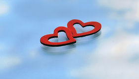 Two red hearts on the background of sky reflection royalty free stock images