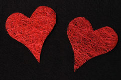 Two red hearts on black background Stock Images