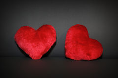 Two red hearts on black leather Royalty Free Stock Photos