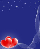 Two red hearts on blue background Stock Photos