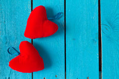 Two red hearts on blue Stock Photo