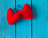 Two red hearts on blue Royalty Free Stock Image