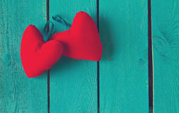 Two red hearts on blue Stock Photos