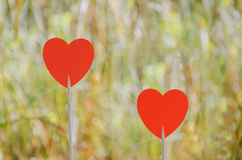 Two red hearts. With bokeh background royalty free stock photos