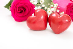 Two red hearts with bouquet of red roses, on white Stock Photo