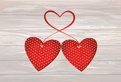 Two red hearts with bow and ribbon. Valentine`s Day. Vector illu. Stration. Greeting card with empty space for the text or advertising. On wooden background Royalty Free Stock Photo