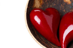 Two red hearts in a bowl of coconut, close-up, isolated Stock Photos