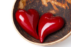 Two red hearts in a bowl of coconut, isolated Royalty Free Stock Images