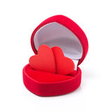 Two red hearts in a box for rings, concept, isolated Royalty Free Stock Image