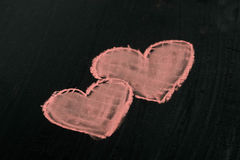Two red hearts chalk drawing on blackboard selective focus macro Stock Image
