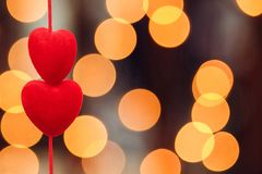 Two red hearts, close-up bokeh evening calm tender background stock image