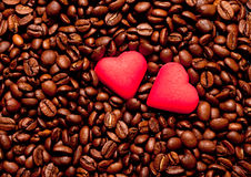 Two red hearts on coffee beans Royalty Free Stock Image