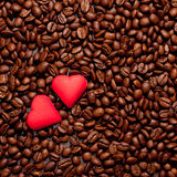 Two red hearts on coffee beans Royalty Free Stock Photos