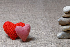 Two red hearts and column of stones Royalty Free Stock Images