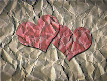 Two Red Hearts on Crumpled Brown Paper Royalty Free Stock Images