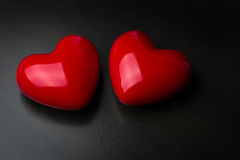 Two red hearts on dark background. St Valentine day Stock Photos