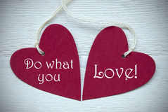 Two Red Hearts With Do What You Love Stock Photo