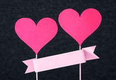 Two red hearts and empty ribbon with copy space Royalty Free Stock Photos