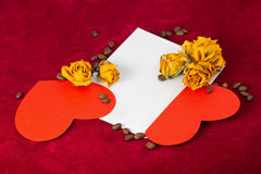 Two red hearts in the envelope with dried roses and coffee beans Royalty Free Stock Photography