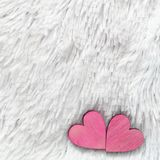 Two red hearts on fur white background. Composition for Valentines day or wedding.Place for text. Copy space. Two red hearts on fur white background Royalty Free Stock Photography
