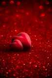 Two red hearts with glitter. For background of Valentine day Royalty Free Stock Photography