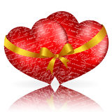 Two red hearts with golden bow and ribbon Royalty Free Stock Photos