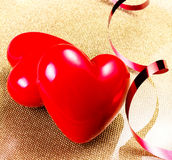 Two Red Hearts on golden plate close up. Valentines Day backgrou Stock Photography