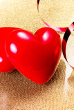 Two Red Hearts on golden plate close up. Valentines Day backgrou Royalty Free Stock Images