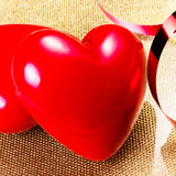 Two Red Hearts on golden plate close up. Valentines Day backgrou Royalty Free Stock Photos