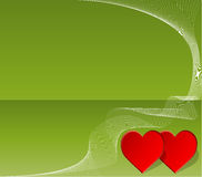 Two red hearts on green background Stock Image