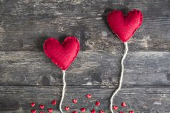 Two red hearts icons of love and valentine`s day. Two hearts like balloons on a wooden background Royalty Free Stock Images