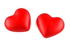 Two red hearts isolated on white. Background stock images